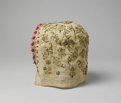 Woman's cap  Date: 1500–1525 Culture: Italian, Venice Medium: Linen and silk, metal-wrapped thread, glass beads Dimensions: L. 9 x W. 7 3/4 inches (22.9 x 19.7 cm) Classification: Textiles-Embroidered