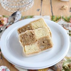 A traditional British cake called Battenberg, this one is with coffee butter cream, walnuts,vanilla taste and then covered with Marzipan.