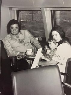 Johnny Cash & June Carter with son - both songwriters, singers
