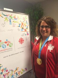 July 13 - Shooting - Women's Trap.  Canada's Amanda Chudoba and her gold medal.