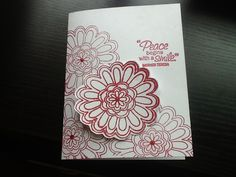 Stamped and raised flower embossed with red sparkly embossing powder