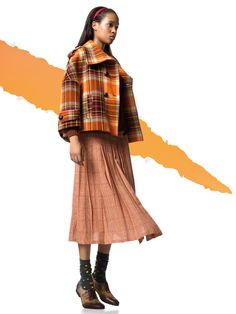 """""""In this image: Jacket (2M1WS31B3); Skirt (4M3XS01W4); Socks (6AO3U216L); Shoes (8GGGB3091). Fall/Winter 2012 United Colors of Benetton woman collection."""""""