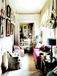 skinny space-love the padded bench in front of the windows.  For when I turn my hall into a library