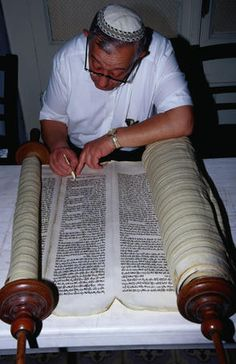 The Torah, Izmir province, Turkey  Rabbi restoring a 300 year old Torah. The Torah is a sacred Judaic scripture- Izmir, Izmir province, Turkey