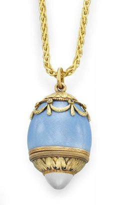 Antique:  AN ENAMEL, MOONSTONE AND GOLD PENDANT, BY FABERGE   Designed as a blue guilloché enamel scent bottle egg pendant, enhanced by sculpted 18k pink and yellow gold garland, swag and palmette detail, the swags set with rose-cut diamonds, the removable stopper base set with a cabochon moonstone, suspended from a fine link gold chain, mounted in silver gilt and gold, circa 1908-1917, 1¼ ins., neckchain 30 ins.  By Fabergé, with workmaster's mark of Henrik Wigström, St. Petersburg,