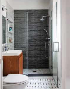 small contemporary bathroom small vanity basketweave floor tile dark grey back wall light grey side walls frameless shower