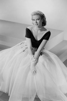 A tulle skirt, silk gloves, and pearls, 1954.   - TownandCountryMag.com