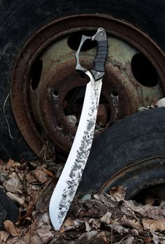 The Backwoods Bone Machete with optional hand guard.