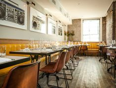 Charlie Bird NYC | Apart from the tasty Italo-American dishes—a now famous uni pasta, homemade spaghetti (kids go nuts for it), perfect roast chicken—the music is what really sets this restaurant apart.