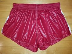 Shiny red shorts with white stripe