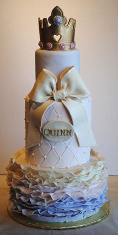 Princess ruffle cake. Three tiered fondant cake with ombre fondant ruffles, fondant bow and gold princess crown.