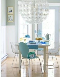 This dining room is eclecticism at its best. A well-appointed mix of mid-century chairs combined with a rustic table and modern pendant light makes this space appear effortless, yet very stylish. The flood of natural light is always a great accessory courtesy of Mother Nature. by Restyled Home