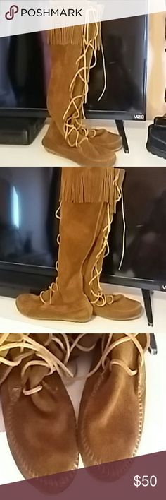 Minnetonka  suede tall moccasins Brown suede tall lace up moccasins.  Minnetonka brand Boho style heels and soles are in great condition. Minnetonka Shoes Lace Up Boots