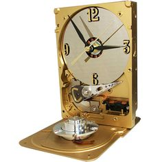 Go for the GOLD. Metallic Gold Hard Drive Clock. Spindle Accent on Base. On Etsy.  Celebrate our victories with this awesome recycled hard drive, now a clock.