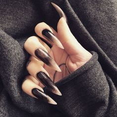 This is how I imagine Stazja's claws.  Black and white cause she's Demonic and Angelic