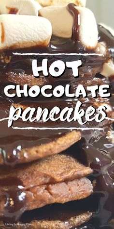 Fluffy and delicious Hot Chocolate Pancake recipe! The best easy, homemade pancake recipe from scratch! Give your weekend breakfast idea a kick with this fluffy pancake recipe. Hot chocolate pancakes made with cocoa powder, chocolate syrup and covered in marshmallows will be your new favorite kids' breakfast idea! #pancakes #pancakerecipe #hotchocolate #breakfast #hotchocolate #livinginhappyplace #chcoclate #hotbreakfast #makeaheadbreakfast #delicious #yummy #sweet #recipes #food