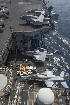 USS Dwight D. Eisenhower (CVN 69) elevator can lift two combat planes from the hanger to the flight deck.