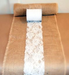 How to DIY your own burlap and lace table runners for your wedding. This tutorial is great for a bride on a budget!