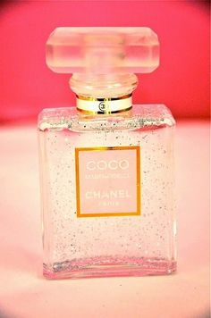 Reuse empty perfume bottles glitter / sequins as decor. Use the gel they put in vases? That looks like water...
