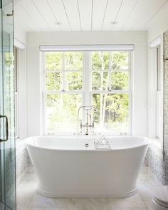 Love the window behind the tub