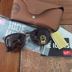 NWT ERIKA RAY BANS Not authentic but the only thing that is different is that the Erika logo isn't in the inside arm band. Everything else is identical. Brand new and comes with everything pictured! These ones are a brownish burgundy see through like picture two :) Ray-Ban Accessories Sunglasses