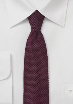 This is a must have skinny tie in a dark shade of rosewood burgundy.