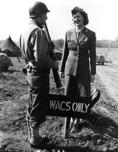 WAC Technician (T/5) Georgiana M. Anderson (right) of Ashland, Wisconsin has a chat with an unidentified military police officer. Anderson was stationed in the San Marco Area of Italy with the WAC 6669th Headquarters Platoon supporting the Fifth Army. Date:	April 12, 1944 Related Collection:	Westray Battle Boyce Long Papers http://www.trumanlibrary.org/photographs/view.php?id=48218
