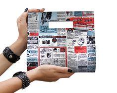 Bolsa de mão em técnica de cartonagem, coberta com tecido importado. A posição da estampa pode variar. R$ 90,00