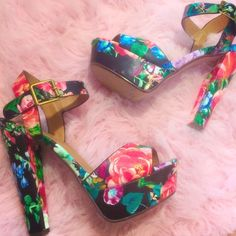 Floral Print Heels - Size 7  Floral print heels - Size 7. Open toe, ankle strap w/ buckle closure  CUTE AF AND PERFECT FOR THE UPCOMING SPRING WEATHER  Shoes Heels
