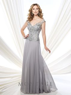 Chiffon, tulle, and lace A-line gown with hand-beaded lace illusion cap sleeves and front and back V-necklines, gathered skirt, sweep train. Matching shawl included. Sizes: 4 – 20, 16W – 26W