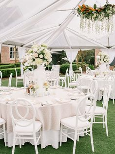 She is totally setting the trend - White Glass vases!  So classy and clean, and easy to dress up.  [Berkeley Hall Weddings] Photo from Lauren and Lyon collection by Rach Loves Troy Photo + Cinema