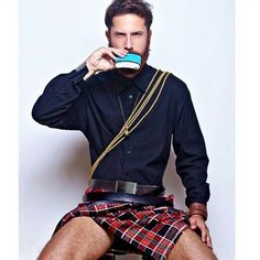 Sexy ginger wearing a plaid kilt drinking from a Keelan Rogue FLASK.   Available at KeelanRogue.com
