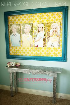 Giant Frame - Pictures mounted on foam board, fabric for the background all in a giant (spray painted) frame. Love this for a big blank wall.