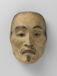 Mitsunaga | Masker, Mitsunaga | No-masker, voorstellende yase-otoko, de magere man. De zwarte puntjes zijn een kopie van de beschadigingen/restauraties van een eerder origineel, dat hier in zijn geheel is gekopieerd. Typerend voor Mitsunaga is de neus-insnijding, die aan de onderzijde schuin loopt en waarvan de bovenkant doorloopt tot boven de oogopeningen.