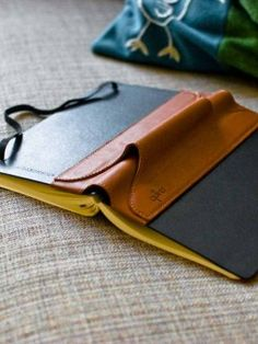 Single Pen Quiver for Large Notebooks - leather $35.95  It would be cool to do this with leather on the outside of any notebook