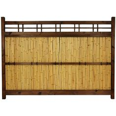 Narrow Japanese bamboo garden fence featuring authentic bleached bamboo poles. Dark walnut stained wood frame. Criss-cross bamboo lattice and supportive cross-beam both have decorative black ties. At just shy of four feet tall and one-and-a-half feet wide, the perfect sized panel for small gardens, tight corners, or narrow spaces.
