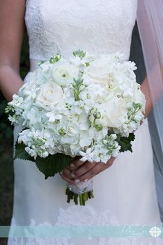 classic green and white spring  bouquet ...so pretty with the lace on her wedding gown!  photo by Robin Lin Photography