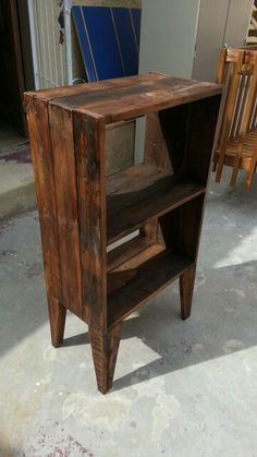 Small stand alone cupboard made out of old pallet wood and finished with a colour varnish.