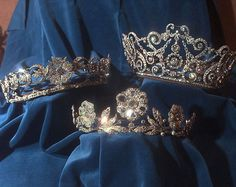 Tiaras from the royal collection. From left: The Duchess of Teck Diamond Tiara, the Strathmore Rose and the Delhi Durbar.