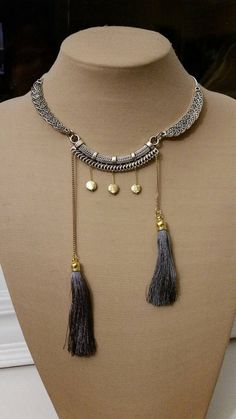 Check out this item in my Etsy shop https://www.etsy.com/ca/listing/270455320/tassel-and-charm-necklace-boho-necklace