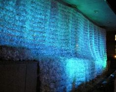 This wall of water art installation by Katharine Harvey was displayed on the north side of the Ontario Power Generation Building. Harvey constructed this project by shaping recyclable plastic bottles into ripples with nylon netting. Theatrical lighting adds the final touch to this dramatic artwork.