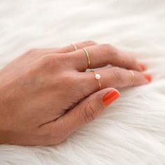 Keep it simple with a delicate pearl ring! Make your own by following this easy DIY tutorial.