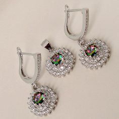Shimmering silver set of jewelry including silver pendant and a pair of silver earrings festooned with multi-colored Rainbow Topaz and White Topaz gemstones..!! #jewelexi #silverjewelry #silverpendant #silverearrings #pendant #earrings #studs #silverstuds #rainbowtopaz #gemstone
