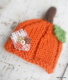 Pumpkin Hat, Knit Baby Cap Knitted Newborn Infant Fall Photo Prop, Halloween, Sweet Fall Patchwork Accent. $20.99, via Etsy.