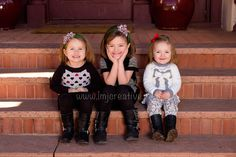 Sisters on steps. Three beautiful young girls sitting on steps outside the farmhouse at Rock Ledge Ranch in Colorado Springs.   Children's Photgraphy by LMJ Creative Expressions. www.lmjcreative.com