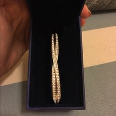 Swarovski bracelet Wore this once! It is in great condition and still in box! Swarovski Jewelry Bracelets