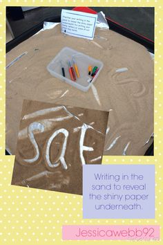 Writing in sand to reveal the shiny paper beneath. EYFS