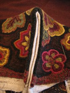 Sewing side seams on your rug hooked footstool