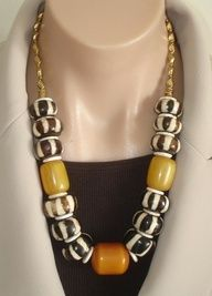 CLICK HERE TO BUY:   www.etsy.com/...  ASHIRA Large Brown & White Cream African Batik Bone Beads and Large Copal African Amber Beads. $265.00, via Etsy.