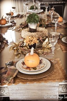 Beautiful tablescape for Autumn/Halloween....would be fun for each guest to carve their own individual pumpkin after the meal!